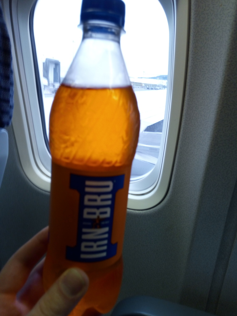 A bottle of Irn Bru in an aeroplane.